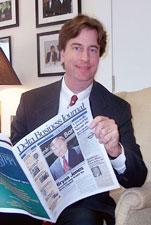 A photo of English alumnus Scott Coopwood reading.